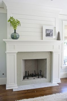 Love the planked wall above fireplace, tile