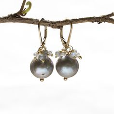 Freshwater Pearls finished with a lovely ruffle of Labradorite are business and dressy staples to any earring wardrobe. Each pair are carefully matched and will be unique since they are natural from t