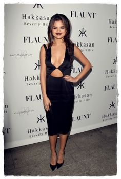 Dare to show a little skin! Selena Gomez reveals her cleavage in this cut-out black dress from Cushnie Et Ochs at Flaunt Magazine's Issue Party.