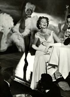 Suzy Parker photographed by Richard Avedon at Moulin Rouge (founded 1889) for Harper's Bazaar, 1957.