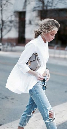 A modern and chic take on the classic denim and white shirt combo.