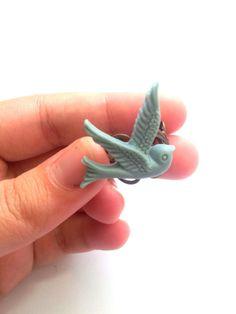 Grey swallow bird resin cabochon ring fixed on by HirasuGaleri, $9.90