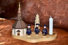 By buying these handmade, traditional German candle holder with Salvation Army figurines you can support the work of the Salvation Army in Chemnitz. Chemnitz is located on the boundaries of the Ore Mountains where the famous nutcrackers originate from. Find further info at: www.heilsarmee.de/ore-mountains-figurines
