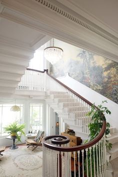 attractive stairway railing and peaceful sitting room.