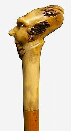 An 1890 Austrian walking stick. A Deer horn carved depicting a faune head . Cane wood of bamboo. Walking Sticks And Canes, Walking Canes, Cane Sword, Folding Cane, Walking Staff, Cane Handles, Cane Stick, Wood Carvings, Umbrellas