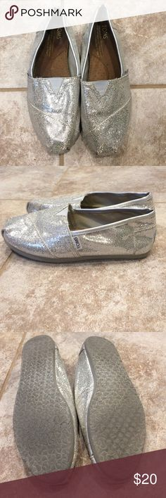 TOMS Silver Glitter Slip-Ons Like little disco balls for your feet! 😀 Worn, but lots of life left. Still in great shape! A little of the glitter is missing on the toes and heels, but you can't tell unless you're right up on them looking for it. toms Shoes