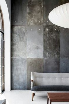 """Could have walked in the sky but we stare at the wall..."" - SUEDE - (A clever interior solution designed with concrete panels and shades of grey)"