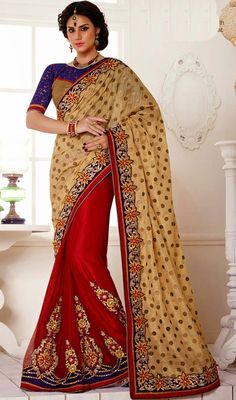 Ethnic cream and red blended silk, bhagalpuri silk, net sari is planned on half n half sari with inspired motifs. The first red half of the drape is embellished with lace, silk thread embroidered floral appliqued motifs and crystal stone and that of other cream half of the drape has lace, silk thread embroidered floral border, polka dotts, crystal stones and dangler which gives you an alluring look. #NewLovelyLookDesignerSaree
