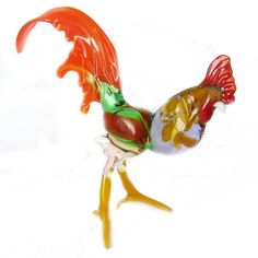 New Products. Glass Rooster Figure is a hand-created figurines in technique of blowing of ... http://russian-crafts.com/glass-figurines/glass-birds/glass-rooster-figure.html