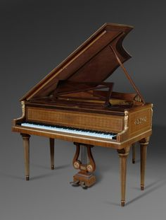 Circa 1900  Origin: Paris  Height: 39″ (138cm) Width:57″ (144.7cm) Depth:62.5″ (158.7cm) Top Open Height: 71″ (180.3cm)  Maker: Ignaz Playel Serial Number: 145638 Interior Marked: Pleyel, Wolff, Lyon et Cie  Pleyel is one of the most celebrated and renowned piano names in history. Ignaz Pleyel was not only a piano manufacturer, but […]