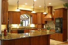 oak kitchen cabinets with countertop and back splash   Sienna Bordeaux Granite Kitchen Countertops With a double full ...