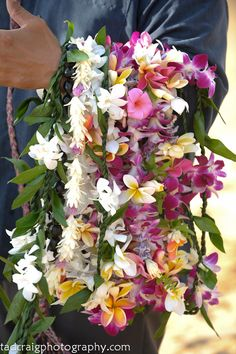 Leis! Hawaiian style! Maui, Hawaii. #leis, #mauiflowers, #mauiweddingleis Photo by Tad Craig Photography