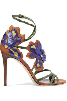 "Jimmy Choo's leather 'Lolita' sandals are ""inspired by the natural grace of the Iris flower."" They feature hand-stitched metallic purple and gold florals carefully appliquéd on green stem-like straps that delicately wrap around your foot. We love them with printed dresses."