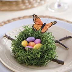 Nest of Sweets.      Taking a ball of green Spanish moss or excelsior in your hands, hollow out an opening with your thumbs.      Hold the formed nest in place by wrapping a single strand of florist wire around the outside edge of the moss.      Place twigs cut from garden on a salad plate, top with the nest, and fill it with pastel candy eggs or Jordan almonds.      Finish with a silk butterfly.