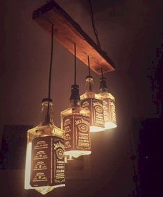 Wonderful Diy Bottle Lamp Design Ideas You Must Know - Lighted wine bottles are a creative way to light up a special occasion or give a unique gift to someone special. If you have a lot of empty bottles ar. Diy Bottle Lamp, Bottle Chandelier, Bottle Bottle, Jack Daniels Lampe, Jack Daniels Bottle, Luminaire Original, Diy Lampe, Lighted Wine Bottles, Liquor Bottle Lights