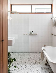 Home Interior Design A Low-Tech Handmade House Clad In Shingles.Home Interior Design A Low-Tech Handmade House Clad In Shingles Bathroom Renos, Laundry In Bathroom, Remodel Bathroom, Bathroom Renovations, White Bathroom Wall Tiles, Washroom Tiles, Neutral Bathroom Tile, Bathroom Store, 1950s Bathroom
