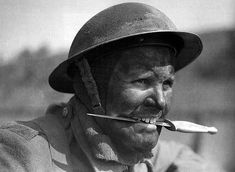 Brit Commando training, Achnacarry, Scotland. ~ A Fairbairn–Sykes fighting knife is clenched between his teeth.