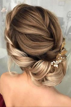 A Twisted Halo Braid #weddingupdo #weddinghai #halobraid #twistedupdo #braidedcrown ❤️ Whether you prefer loose or vintage hairstyles, find the elegant wedding updos for long hair for bride or bridesmaid with us. ❤️ See more:  #lovehairstyles #hair #hairstyles #haircuts