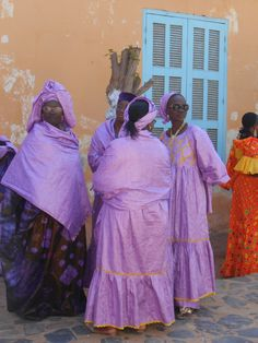 picture taken on Goree Island waiting to start a parade on Senegalese Independence Day 2013 by Penney Hughes.  More of her art can be found at bloomingwyldeiris.blogspot.com