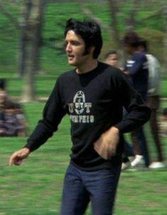 1969 - ELVIS PLAYING FOOTBALL DURING BREAK ON SET.
