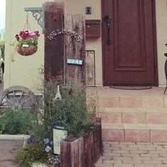 nahhoさんの、車輪,ハンキング,枕木門柱,かすみ草,玄関/入り口,のお部屋写真