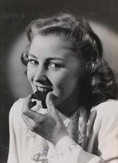 Eat less chocolate (Woman eating chocolate, Unknown, National Media Museum)