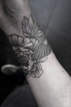 Floral blackwork arm wrap tattoo...still debating whether or not to have mine shaded. I'm liking the way this looks though.