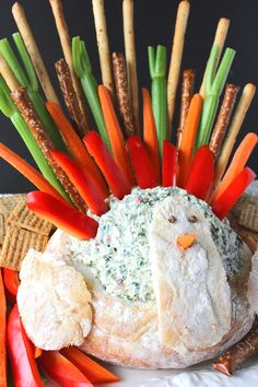 Amaze your family and friends this Thanksgiving with this Turkey Bread Bowl Appetizer with Creamy Spinach Ranch Dip. He's super easy to recreate, and Mr. Tom Turkey's tail feathers play double duty as the dippers. What could be more fun? - Kudos Kitchen by Renee - www.kudoskitchenbyrenee.com