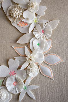 Felt flower white wreath.  Might be nice with red & green for the embroidery.