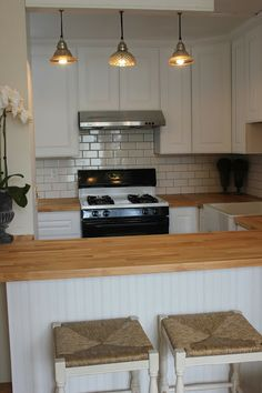 Summersoul - apron sink, subway tile, and wood countertops