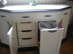 Here is is with the doors open...we kept the drawers for storage and added a pull out trash bin.