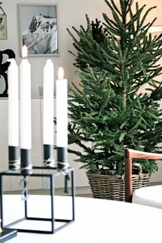 a nordic christmas - natural green fir tree - basket and black metal cube advent candle holder - Via Studio Karin | A Nordic Christmas | Black and White | By Lassen