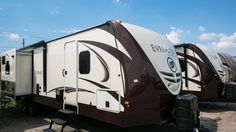"""LARGE ON LUXURY, LITE FOR TOWING!!!   2015 EverGreen Everlite 291RLS  Enjoy residential features inside of this 35' 3"""" long, 7400 lb. travel trailer such as a living room skylight, crown molding, and beautiful barreled ceilings. Sleep comfortably on your innerspring pillow top mattress. Go RVing in any climate, hot or cold, with the heated and enclosed underbelly!   Give our Everlite expert Chad Sterkenburg a call 616-359-6990 for pricing and more information."""