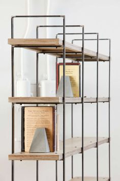 Bookcase with metal uprights and wooden shelves from oak or painted plywood. Custom size available on request.