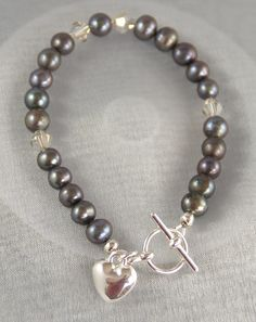 Dark grey freshwater Pearl swith Swarovski crystals, which can be changed for colour of your choice, silver plated toggle & heart charm.