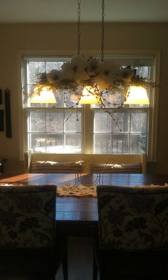 My dining room light fixture decoration, made with 4 boxwood branches, a willow branch, 3 magnolias, and 2 poinsettias.