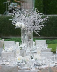 Even though Frozen came out after I started planning, it's one of my favorite Disney movies and is definitely going to be represented at the wedding. This is a cute Winter-esque centerpiece that could be a subtle nod to Frozen
