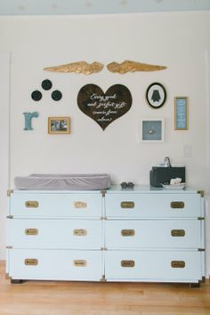 Reed's Soft, Starry Space — Nursery Tour I'd like to find a store that sells hardware like this so I can update Molly's ikea malm dresser so it looks similar to this changing table/dresser.