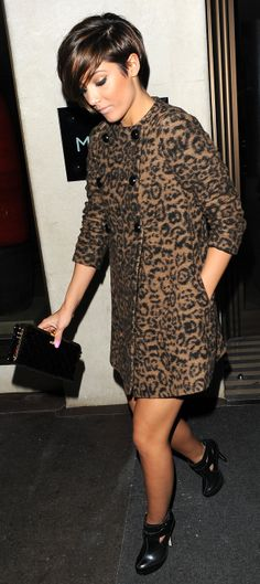 You can never go wrong with leopard print. Frankie Sandford wears black high heel ankle boots with her double breasted leopard print jacket and black clutch.