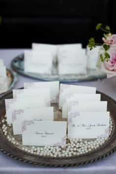 Escort cards arranged on silver trays with pearls scattered along the bottom. Maybe have them displayed at different heights. Wedding Photo Gallery, Wedding Photos, Wedding Reception Decorations, Wedding Favors, Wedding Cards, Our Wedding, Marry Me, Flower Decorations, Wedding Inspiration