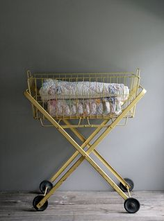 vintage laundry cart in buttercup yellow. Wouldn't you love to find one of these Sis?