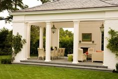 Love this porch - bluestone flooring and lanterns.