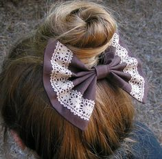 Hair Bow Chocolate Brown and Lace Fabric by ClipaBowBoutique// Hair in bun with bow nestled beneatht he bun. @chelseyluehr