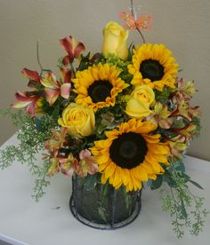 Yellow Roses, Sunflowers and accent flowers arranged in a rustic vase by your local Riverside florist - Willow Branch Florist of Riverside http://www.floristofriverside.com/