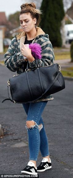 Melancholy: Dressing for comfort on her walk, Perrie wore black and white trainers...