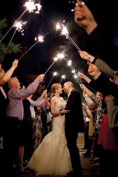 Love this DIY sparkler canopy idea.    Photography courtesy of Lee Weston Photography.