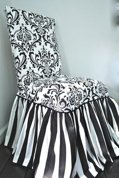 I had this cover made for my kitchen chairs.  Damask and Stripe Chair Slipcover by PaulaAndErika on Etsy, $95.00