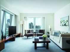 Spacious living room in Residence Suite at Langham Place, New York, Fifth Avenue featuring Alex Katz artwork. Photo Credit: Michael Weber
