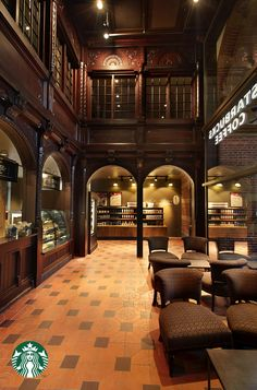 This Starbucks store is located in the historic central train station of Copenhagen. The original architectural detail remains untouched. The existing theatrical wooden arches serve as the face of the bar and beautifully frames the entire store.