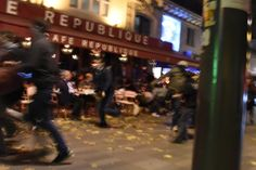 People run after hearing what is believed to be explosions or gun shots near Place de la Republique square in Paris. Dominique Faget / AFP / Getty Images